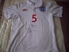 Rio Ferdinand signed England shirt with COA.