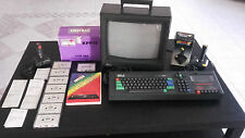 "Amstrad CPC 464 + box games KPP15 with ERROR PRAITED ""100 games on 7 audiotapes"""