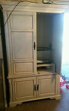 White tall entertainment center.  N local pick up only. DFW TEXAS
