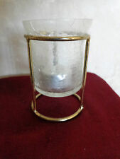 Votive Candle Light Holder on a Gold Metal Stand.