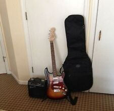 Squier by Fender with mini amp'