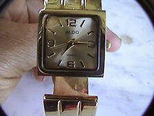 aldo gold tone cuff bracelet women's wrist watch