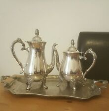 silver plated tea and coffee pot on a cavalier silverplated tray