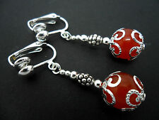 A PAIR OF DANGLY BURNT ORANGE JADE  BEAD  SILVER PLATED DROP CLIP ON EARRINGS.