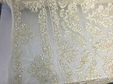 Ivory/ Metallic Gold French Design Embroider And Hand Beaded On A Mesh Lace-