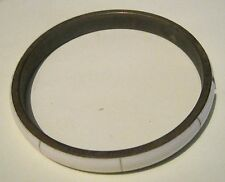 Lovely bronze tone metal bangle style bracelet with white design exterior
