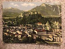 POSTCARD USED AUSTRIA, SALZBURG KAPUZINERBURG AUSTRIA MOUNTAINS IN BACKGROUND