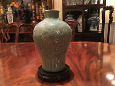 A Chinese Ming Dynasty Longquan Celadon Carved Porcelain Phoenix Vase.