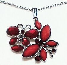 """PENDANT, 2 RED BUTTERFLIES OF GLASS STONES WITH METAL OUTLINE ON A 2"""" METAL BASE"""