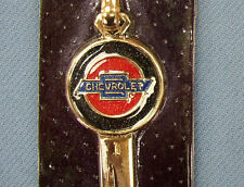 Rare B-10 Chevrolet Yellow Gold Chevy Crest Key NOS on Card 1963 1964 1965 1966