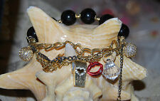 BETSEY JOHNSON WHISTLE LIPS CHARM BRACELET HEART BOW BLACK BEADS CRYSTALS GOLD