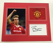 A 12 x 10 inch mounted display signed by Manchester United's Russell Beardsmore.