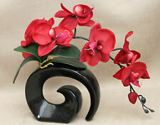 ARTIFICIAL SILK MOTH ORCHID IN RED WITH LEAVES IN BLACK FOSSIL VASE