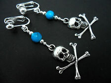 A PAIR TIBETAN SILVER  & TURQUOISE BEAD  SKULL & CROSSBONES CLIP ON  EARRINGS.