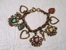 antique gold tone charm bracelet with 8 heart charms and 1 Key charm  8""
