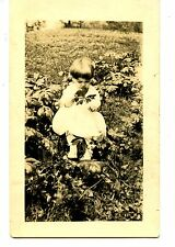 Cute Child in Large Flower Field-Holds Stalk-RPPC-Vintage Real Photo Postcard
