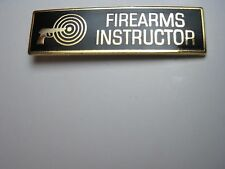 FIREARMS INSTRUCTOR UNIFORM PIN GOLD WITH BLACK ENAMEL POLICE SHERIFF TROOPER*