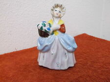 VINTAGE LADY WEARING BONNET w/ FLOWERS   PORCELAIN  FIGURINE...made in JAPAN