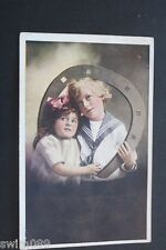 Vintage 1922 postcard with boy in sailor suit and girl.