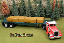 DieCast 1949 Peterbilt Model 380 Semi Flat Bed with Load O-Scale 1:43 by New Ray
