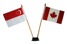 "CANADA & SINGAPORE 4"" X 6"" DOUBLE STICK FLAG WITH BLACK STAND ON 10"" PLAST. POLE"