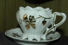 VINTAGE WHITE AND GOLD 8 FOOTED TEA CUP & SAUCER SCALOPED EDGE