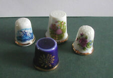 SET OF 4 COLLECTABLE CERAMIC THIMBLES