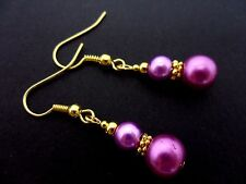 A PAIR OF DANGLY PURPLE GLASS PEARL  GOLD PLATED EARRINGS.