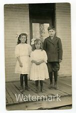real photo postcard Young Boy and girls on porch  RPPC hair ribbon cute