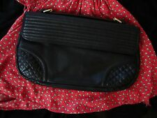 foley and corinna quilty leahter clutch purse in black