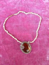 VINTAGE AMBER AND STERLING SILVER PENDANT ON A SEA PEARL STRAND NECKLACE