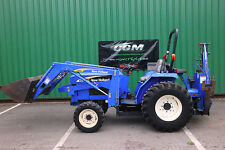 Compact tractor with front loader and back hoe New Holland TC30