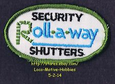 LMH PATCH Badge  QMI ROLL-A-WAY SECURITY SHUTTERS  Electric Roll Up Rollaway  3""