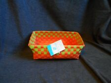 New with tags, plastic woven basket, orange and green