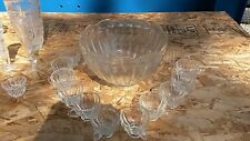 VINTAGE CUT GLASS CRYSTAL PUNCH BOWL. With 13 crystal serving dishes and vases