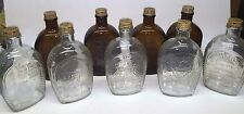9 VINTAGE LOG CABIN GLASS BOTTLES BROWN, AMBER, CLEAR 200TH ANNIVERSARY W/ CAPS
