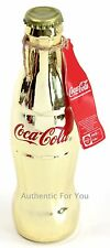 NEW World of Coca Cola Store Sealed Empty 8 oz Gold Glass Bottle