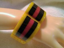 Thick, Carved Yellow, Red and Black Stripe Lucite Bangle Bracelet..