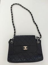 ***CHANEL *** Black leather classic flap shoulder bag. Silver chain.