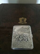 A CIGARETTE CASE EMBOSSED WITH FIGURES AND MARKED PROMA ALP IMPORT