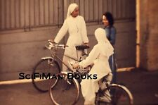 35mm Vintage Slide Pretty Women Traditional Dress Riding Old Bicycles 1970s?