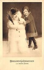 BG20673 child with snowman smoking new year neujahr   germany