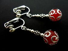 A PAIR OF DANGLY RED JADE BEAD  SILVER PLATED DROP CLIP ON EARRINGS.