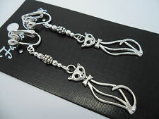 A PAIR OF  TIBETAN SILVER DANGLY CAT CLIP ON  EARRINGS. NEW.