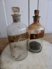 Two antique apothecary chemist's glass bottles with ground glass stoppers