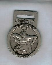 #D205.  2012  LOUISE SAUVAGE SYDNEY RUNNING FESTIVAL MEDAL