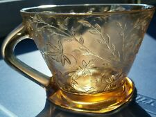 JEANETTE MARIGOLD IRIDESCENT CARNIVAL GLASS FLOWER FOOTED SQUARE BASE TEA CUP