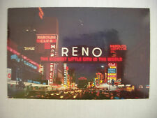VINTAGE PHOTO POSTCARD OF THE RENO ARCH AND VIGINIA ST. IN RENO NEVADA USED