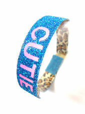 "GLITTERY BLUE  ""CUTIE"" GLOW IN THE DARK BRACELET RAVE PARTY FRESHERS (B4)"