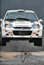 Carlos Sainz SIGNED 12x8  Ford Focus RS WRC  , Rally Great Britain 2000